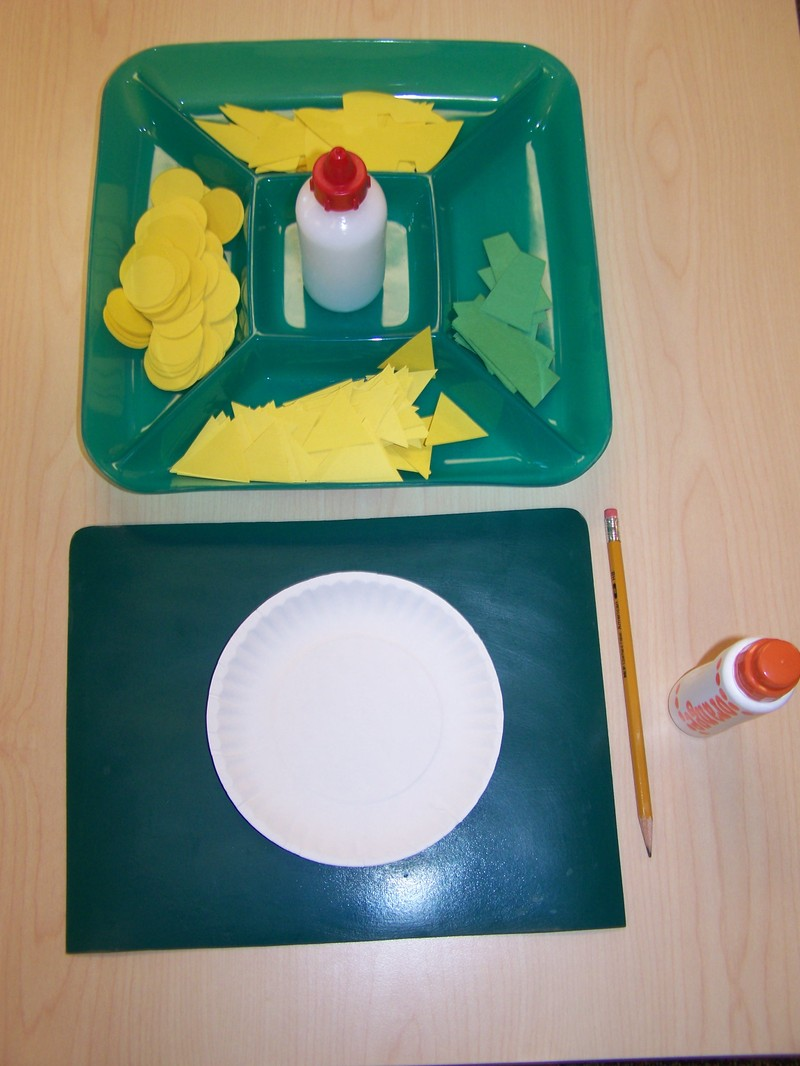 To do this work the child first takes a plate and gluing mat to the table. Then they return to the shelf and carry the green ided tray to their table. & My Montessori Journey: Montessori--Art